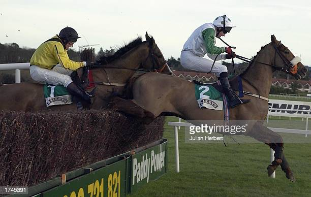 Barry Geraghty and Bust Out lead Ricardo over the last fence to land The Baileys Arkle Perpetual Challenge Cup Novices Steeplechase Race run at...