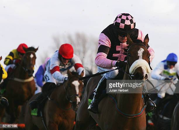 Barry Geraghty and Essex pull away from the last flight to go on and land The totesport Trophy Hurdle Race run at Newbury Racecourse on February 12...