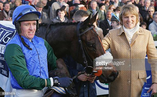 Barry Geraghty and trainer Jessica Harrington with Macs Joy after winning in The AIG Europe Champion Hurdle Race run at Leopardstown Racecourse on...
