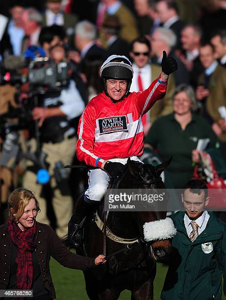 Barry Geraghty celebrates on board The Druids Nephew after winning The Ultima Business Solutions Handicap Steeple Chase during Day One of the...