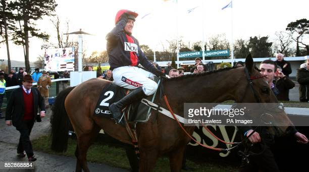 Barry Geraghty enters the parade ring aboard Bobs Worth after winning the Lexus Steeplechase during day three of the Leopardstown Christmas Festival...