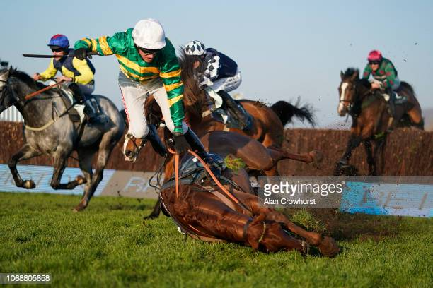 Barry Geraghty falls from Movewiththetimes at Cheltenham Racecourse on November 17 2018 in Cheltenham England