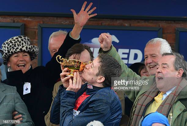 Barry Geraghty kisses the cup after winning the Betfred Cheltenham Gold Cup Steeple Chase riding horse 'Bobs Worth' during the last day of the...