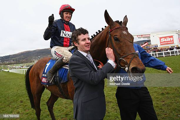 Barry Geraghty on board Bobs Worth celebrates victory in the Cheltenham Gold Cup during Gold Cup day at Cheltenham Racecourse on March 15, 2013 in...
