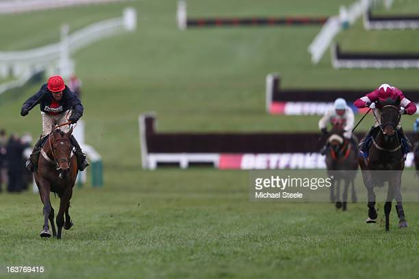 Barry Geraghty on board Bobs Worth on his way up the hill before winning the Cheltenham Gold Cup from AP McCoy riding Sir des Champs during Gold Cup...