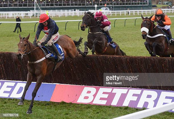 Barry Geraghty on Bob's Worth leads Long Run and Sir des Champs over the last on their way to victory in the Cheltenham Gold Cup Steeple Chase at...