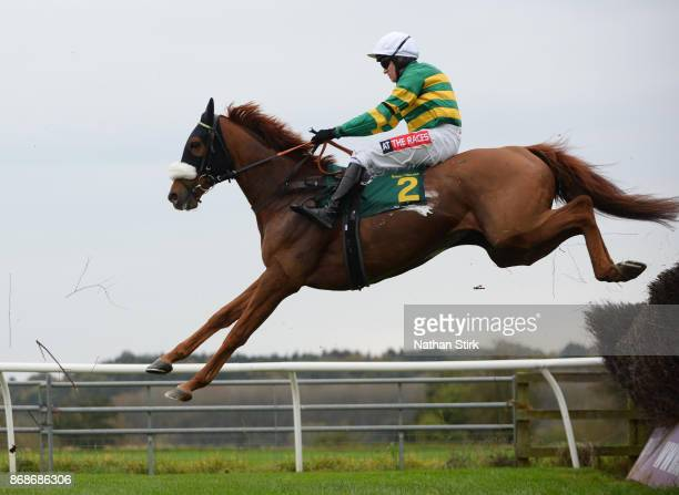 Barry Geraghty rides Modus during The Equine Lens Novices Steeple Chase race at BangorOnDee Racecourse on October 31 2017 in Bangor Wales