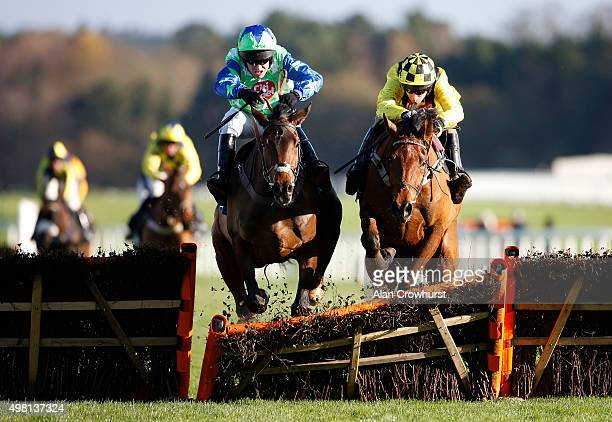 Barry Geraghty riding American clear the last to win The Mitie Events & Leisure Novices' Hurdle Race at Ascot racecourse on November 21, 2015 in...