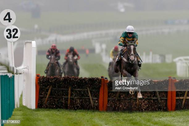 Barry Geraghty riding Apple's Shakira clear the last to win The JCB Triumph Trial Juvenile Hurdle Race at Cheltenham racecourse on November 18 2017...