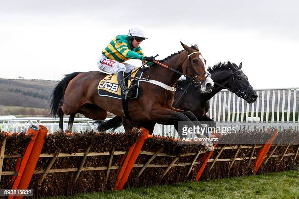 Barry Geraghty riding Apple's Shakira clear the last to win The JCB Triumph Trial juvenile Hurdle Race at Cheltenham racecourse on December 16 2017...