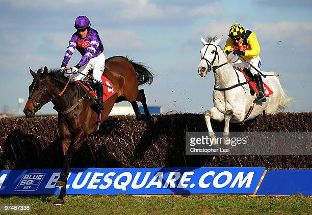 Barry Geraghty riding Big Fella Thanks jumps the final hurdle with Ruby Walsh riding Pasco to win The Raymond Mould Supporting Greatwood Gold Cup...
