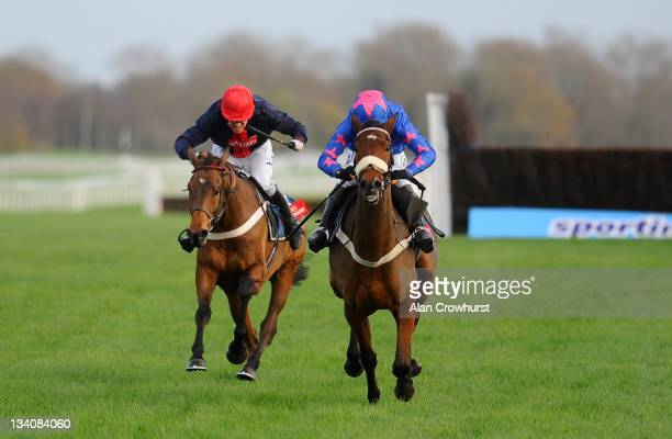 Barry Geraghty riding Bobs Worth challenge on the run in to beat Cue Card and Joe Tizzard to win The Fuller's London Pride Novices' Steeple Chase at...