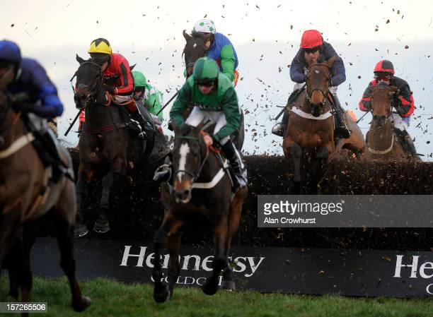 Barry Geraghty riding Bobs Worth on their way to winning The Hennessy Gold Cup Steeple Chase at Newbury racecourse on December 01, 2012 in Newbury,...