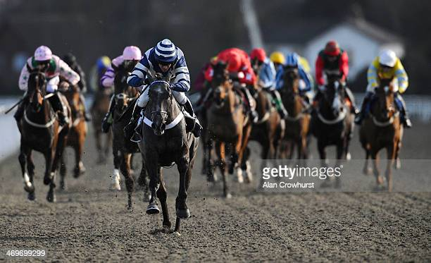 Barry Geraghty riding Bringithomeminty win The Dine In The Panoramic Standard Open National Hunt Flat Race at Kempton Park racecourse on February 16...