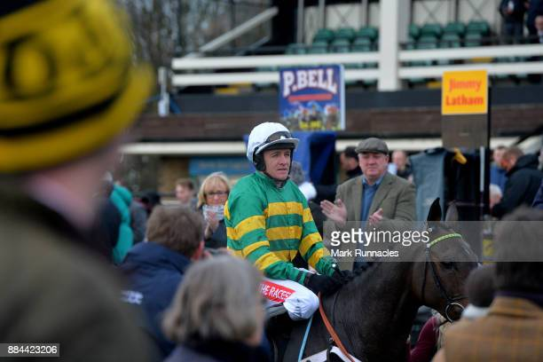 Barry Geraghty riding Buveur D'Air arrives in the winners enclosure after winning the Unibet Fighting Fifth Hurdle Race at Newcastle Racecourse on...
