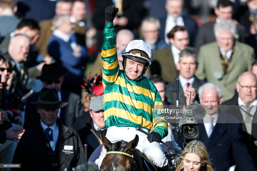 Barry Geraghty riding Buveur D'Air celebrate winning The Unibet Champion Hurdle Challenge Trophy at Cheltenham racecourse on Champion Day on March 13, 2018 in Cheltenham, England.