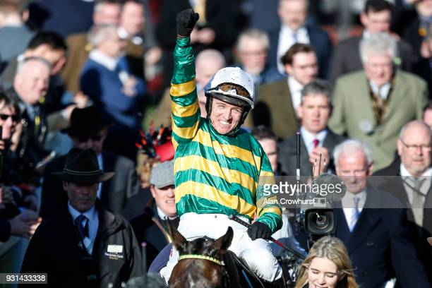 Barry Geraghty riding Buveur D'Air celebrate winning The Unibet Champion Hurdle Challenge Trophy at Cheltenham racecourse on Champion Day on March 13...