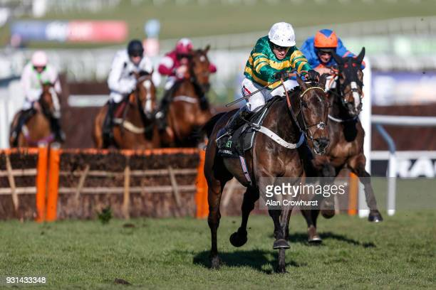 Barry Geraghty riding Buveur D'Air win The Unibet Champion Hurdle Challenge Trophy at Cheltenham racecourse on Champion Day on March 13 2018 in...