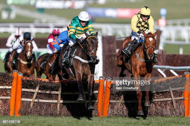 Barry Geraghty riding Buveur D'Air win The Unibet Champion Hurdle Challenge Trophy from Melon at Cheltenham racecourse on Champion Day on March 13...