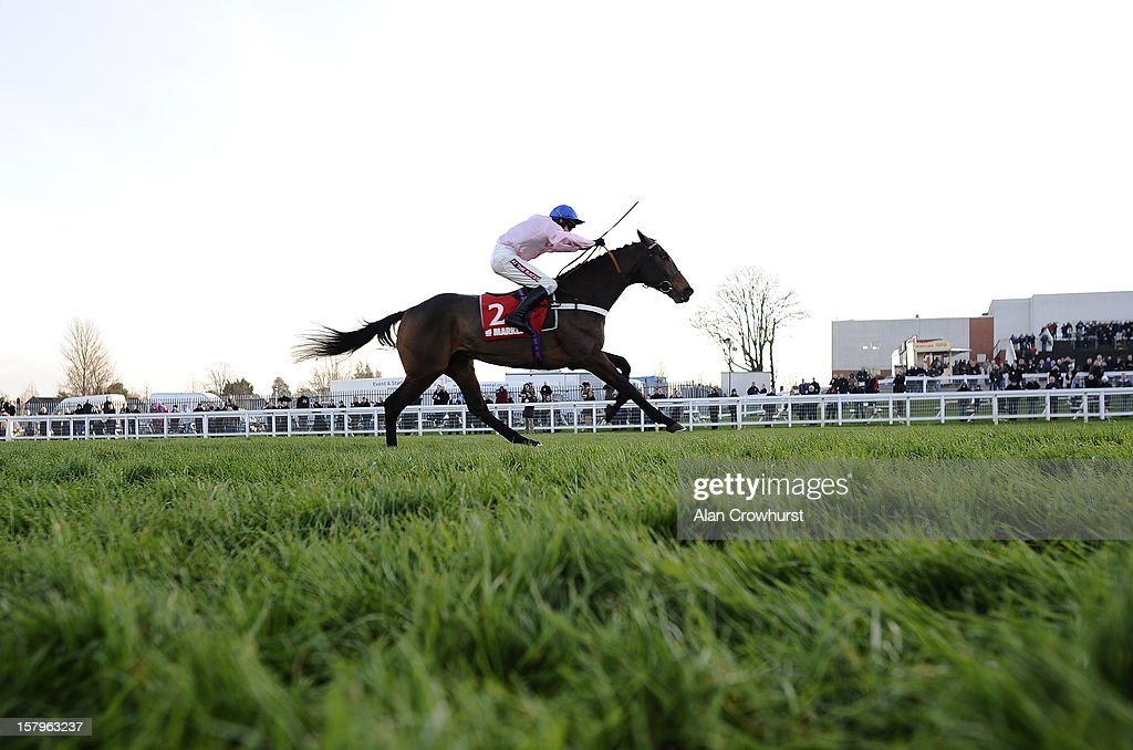 Barry Geraghty riding Captain Conan clear the last to win The Markel Insurance Henry VIII Novices' Chase at Sandown racecourse on December 08, 2012 in Esher, England.