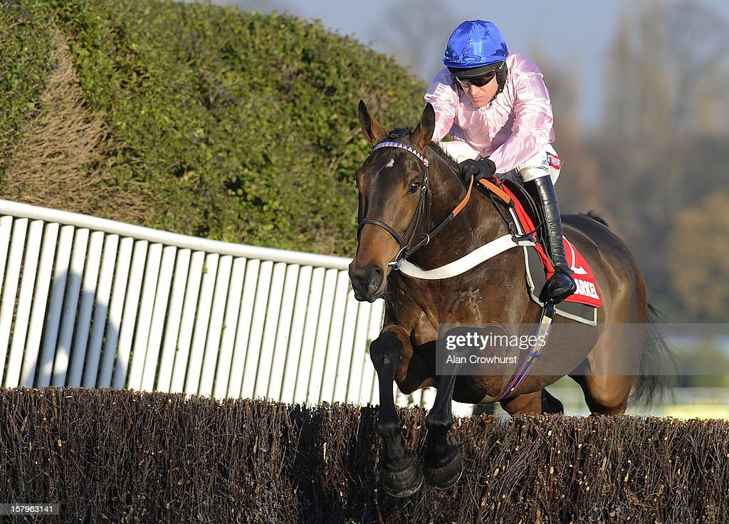 Barry Geraghty riding Captain Conan on their way to winning The Markel Insurance Henry VIII Novices' Chase at Sandown racecourse on December 08, 2012 in Esher, England.