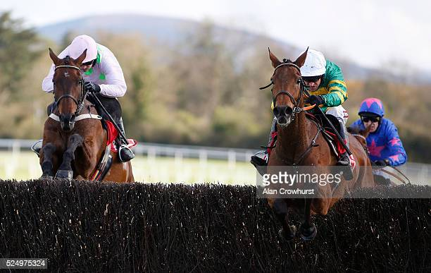Barry Geraghty riding Carlingford Lough clear the last to win The Bibby Financial Services Ireland Punchestown Gold Cup from Djakadam and Cue Card...