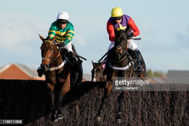 Barry Geraghty riding Champ clear the last to win The KKAHighpoint Beginners' Chase at Newbury Racecourse on November 07 2019 in Newbury England