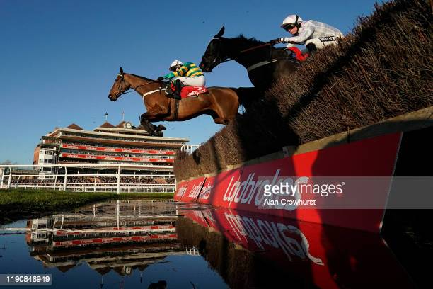 Barry Geraghty riding Champ clear the water jump before going on to win The Ladbrokes 'Where The Nation Plays' Novices' Chase at Newbury Racecourse...