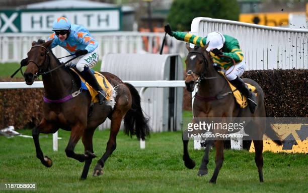 Barry Geraghty riding Defi Du Seuil clear the last to win The Betfair Tingle Creek Chase from Un De Sceaux and Paul Townend at Sandown Park...