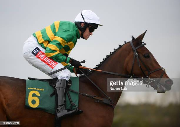 Barry Geraghty riding Dostal Phil during The HN Nuttall LTD Novices Hurdle Race at BangorOnDee Racecourse on October 31 2017 in Bangor Wales