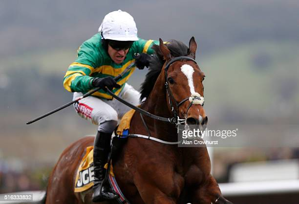 Barry Geraghty riding Ivanovich Gorbatov win The JCB Triumph Hurdle during the Gold Cup Day of Cheltenham Festival at Cheltenham racecourse on March...