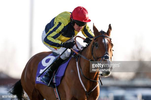 Barry Geraghty riding Master Dee clear the last to win The Betdaq Handicap Chase at Kempton Park racecourse on February 24 2018 in Sunbury England