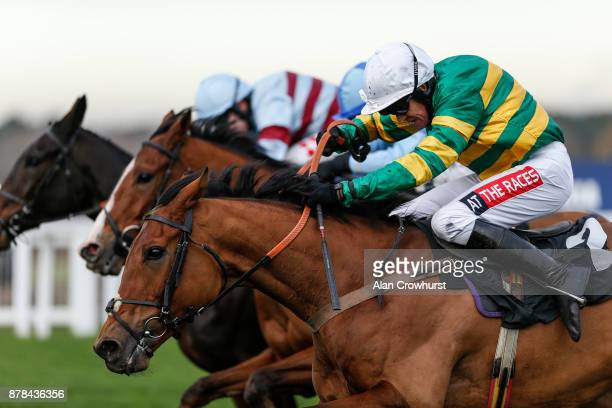 Barry Geraghty riding Mr One More clear the last to win The David Brownlow Charitable Foundation 'Introductory' Hurdle Race at Ascot racecourse on...