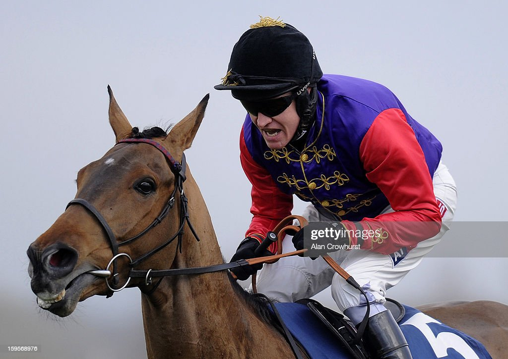 Barry Geraghty riding Open Hearted during the Betfred Double Delight Novices' Chase at Newbury racecourse on January 16, 2013 in Newbury, England.