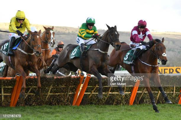 Barry Geraghty riding Saint Roi jumps the final fence on their way to winning the Randox Health County Handicap Hurdle at Cheltenham Racecourse on...