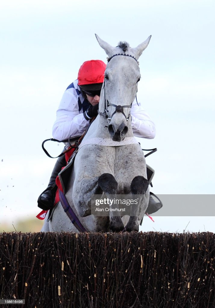 Barry Geraghty riding Simonsig on their way to winning The Betfred Novices' Steeple Chase at Ascot racecourse on December 21, 2012 in Ascot, England.