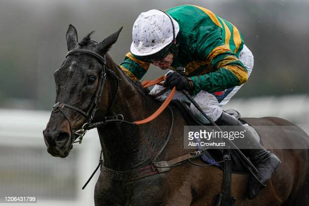 Barry Geraghty riding Sporting John clear the last to win The Thames Materials Novices' Hurdle at Ascot Racecourse on February 15, 2020 in Ascot,...