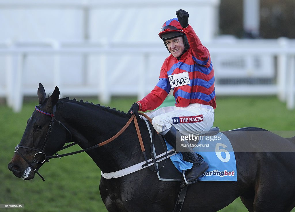 Barry Geraghty riding Sprinter Sacre celebrate after winning The Sportingbet Tingle Creek Chase at Sandown racecourse on December 08, 2012 in Esher, England.