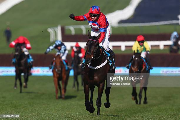 Barry Geraghty riding Sprinter Sacre celebrates victory in the Queen Mother Champion Steeple Chase during Ladies Day at Cheltenham Racecourse on...