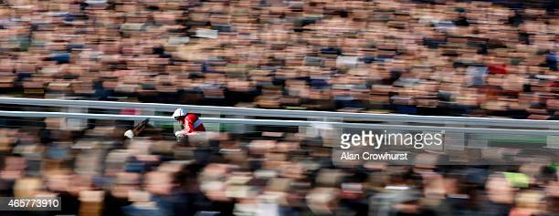 Barry Geraghty riding The Druids Nephew win The Ultima Business Solutions Handicap Steeple Chase at Cheltenham racecourse on March 10 2015 in...