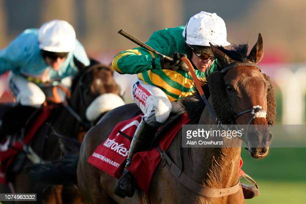 Barry Geraghty riding Unowhatimeanharry clear the last to win The Ladbrokes Long Distance Hurdle at Newbury Racecourse on November 30 2018 in Newbury...