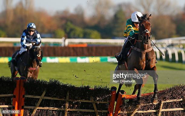 Barry Geraghty riding Unowhatimeanharry clear the last to win The bet365 Lond Distance Hurdle Race at Newbury Racecourse on November 25 2016 in...