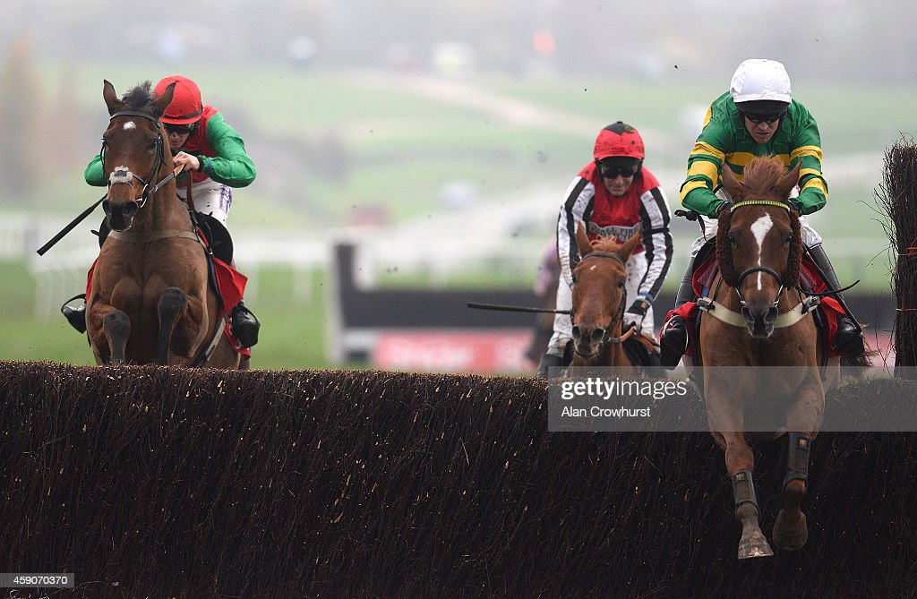 Barry Geraghty riding Uxizandre (R) clear the last to win The Shloer Steeple Chase at Cheltenham racecourse on November 16, 2014 in Cheltenham, England.