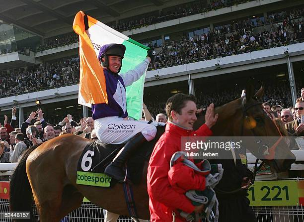 Barry Geraghty shows his delight after Kicking King landed The totesport Cheltenham Gold Cup Steeple Chase Race run at Cheltenham Racecourse during...