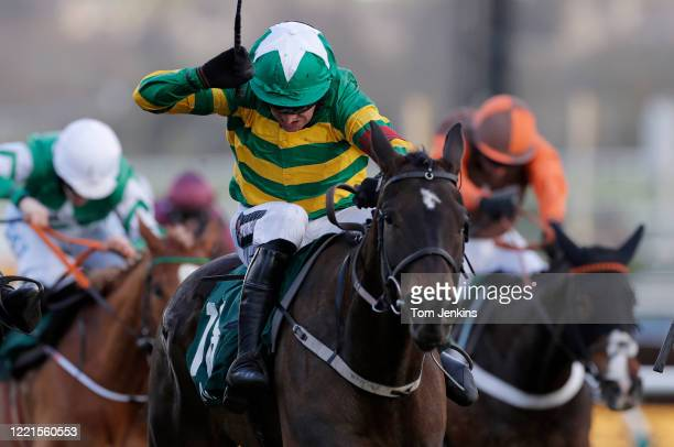 Barry Geraghty uses his whip to guide Saint Roi to victory in the 2nd race during day four of the Cheltenham National Hunt Racing Festival at...