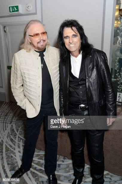 Barry Gibb and Alice Cooper attend the Nordoff Robbins' O2 Silver Clef Awards at The Grosvenor House Hotel on June 30 2017 in London England