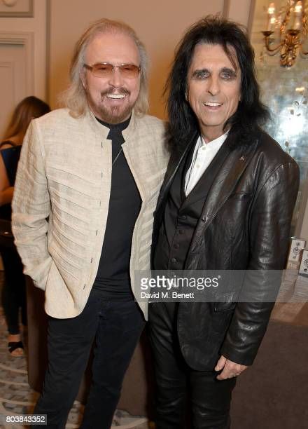 Barry Gibb and Alice Cooper attend the Nordoff Robbins O2 Silver Clef Awards at The Grosvenor House Hotel on June 30 2017 in London England