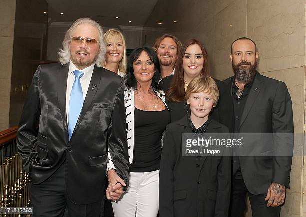 Barry Gibb and Linda Gibb and family and family attending the Nordoff Robbins Silver Clef Awards at London Hilton on June 28 2013 in London England
