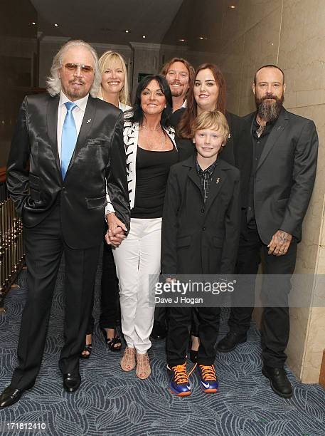 Barry Gibb and Linda Gibb and family attending the Nordoff Robbins Silver Clef Awards at London Hilton on June 28, 2013 in London, England.