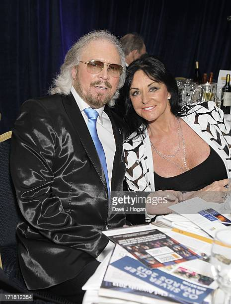 Barry Gibb and Linda Gibb at the Nordoff Robbins Silver Clef Awards at London Hilton on June 28, 2013 in London, England.